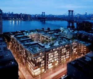 A rendering of Oosten, a full-block condo complex in South Williamsburg being developed by the Xin Development Group International, an arm of a major China-based home-building firm. CreditThe Seventh Art